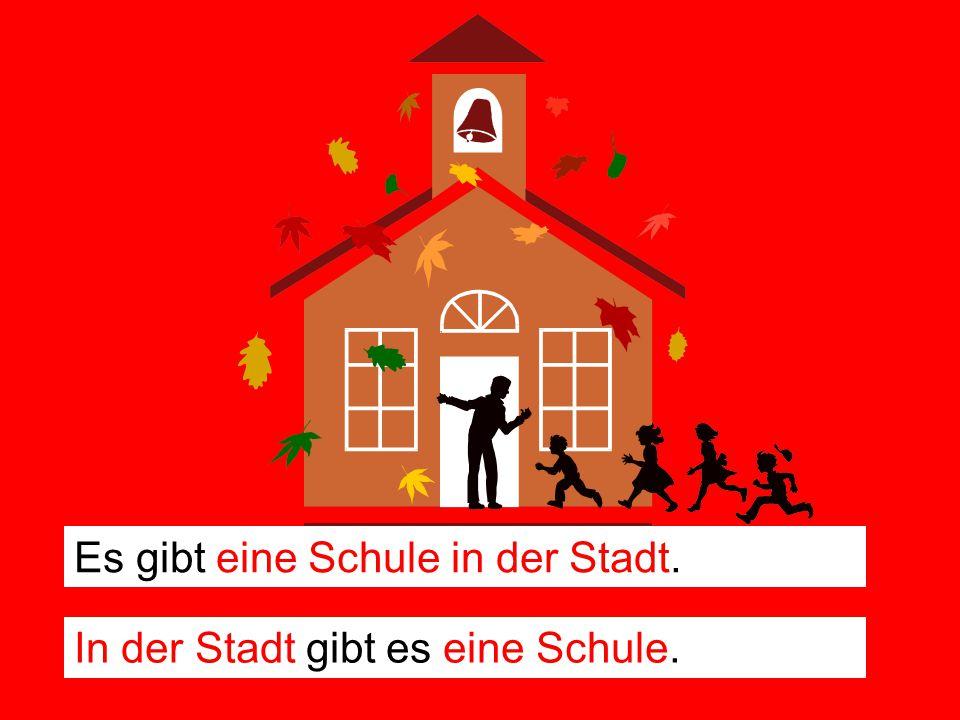 Es gibt eine Schule in der Stadt. In der Stadt gibt es eine Schule.