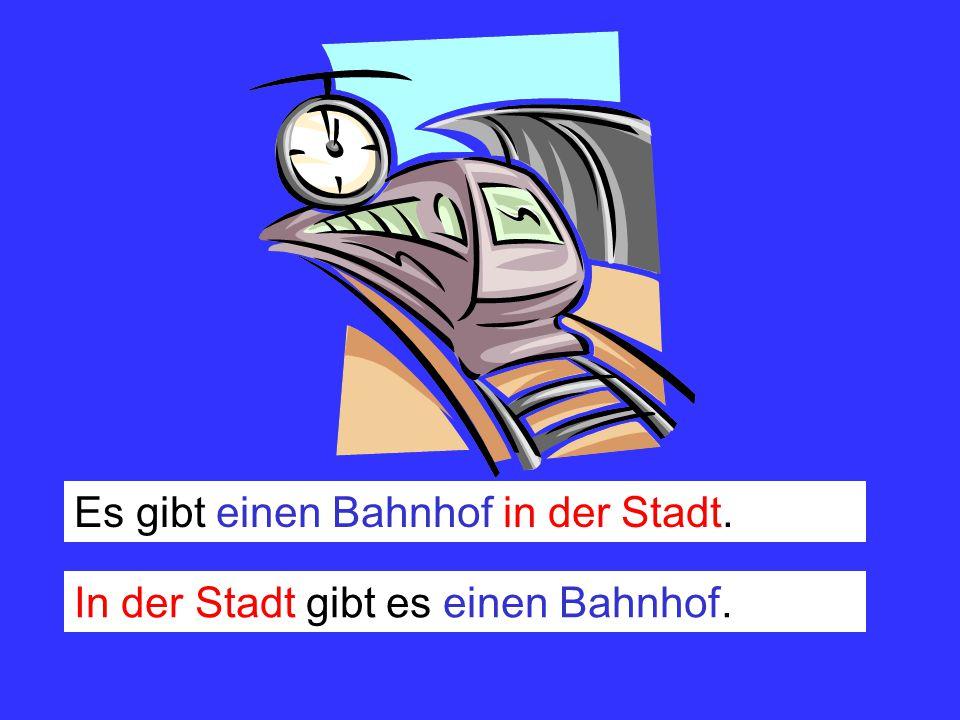 Es gibt einen Bahnhof in der Stadt. In der Stadt gibt es einen Bahnhof.