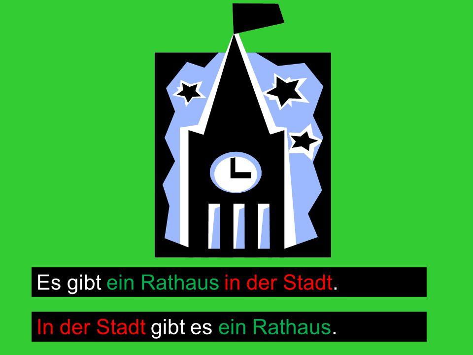 Es gibt ein Rathaus in der Stadt. In der Stadt gibt es ein Rathaus.
