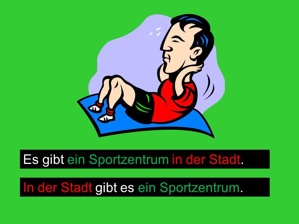 Es gibt ein Sportzentrum in der Stadt. In der Stadt gibt es ein Sportzentrum.