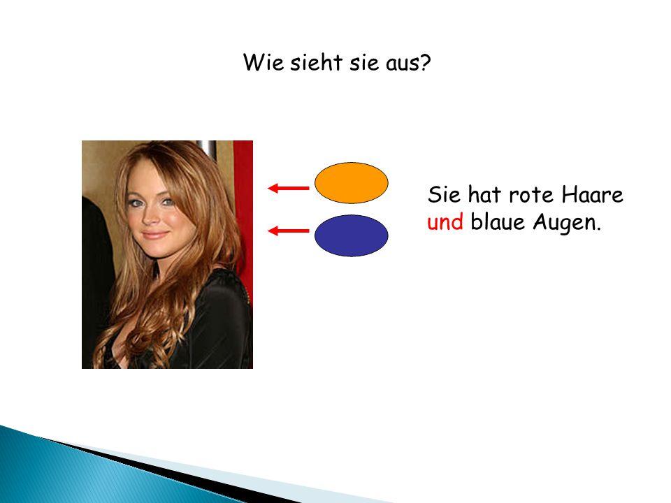 Sie hat rote Haare und blaue Augen. Wie sieht sie aus?