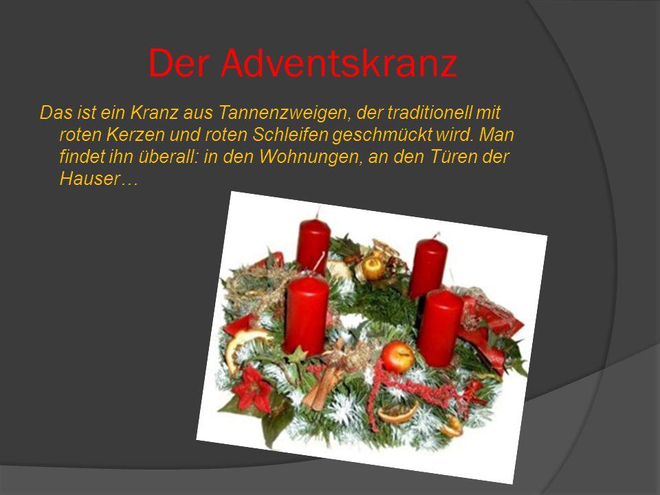 Der Adventskranz Das ist ein Kranz aus Tannenzweigen, der traditionell mit roten Kerzen und roten Schleifen geschmückt wird.