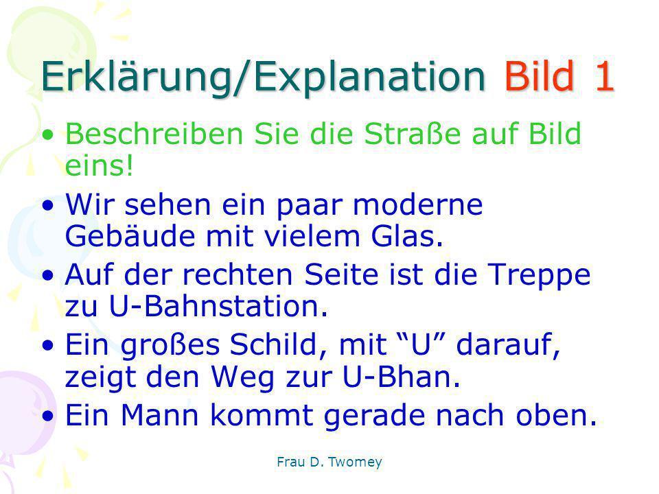 Erklärung/Explanation Bild 1 Beschreiben Sie die Straße auf Bild eins! Wir sehen ein paar moderne Gebäude mit vielem Glas. Auf der rechten Seite ist d