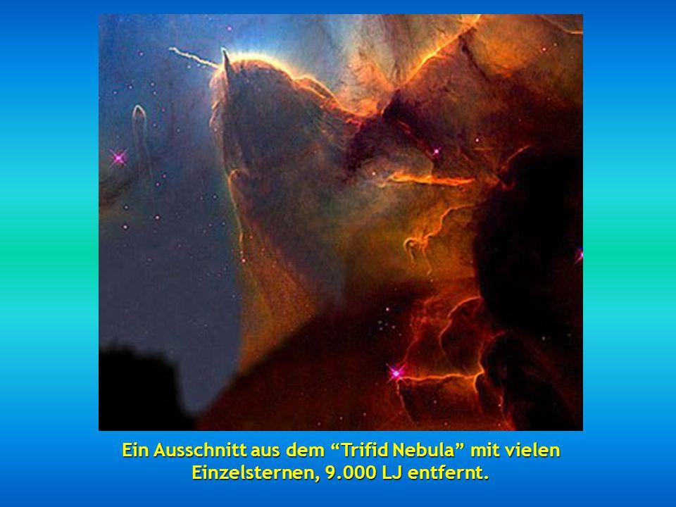 Die beiden 114 Millionen Lichtjahre entfernten Spiral-Galaxien NGC 2207 und IC 2163, die in einer Kollision verschmelzen.