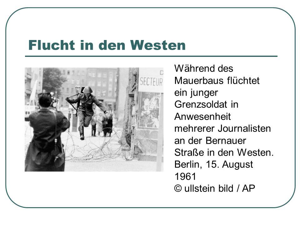 Flucht in den Westen Während des Mauerbaus flüchtet ein junger Grenzsoldat in Anwesenheit mehrerer Journalisten an der Bernauer Straße in den Westen.