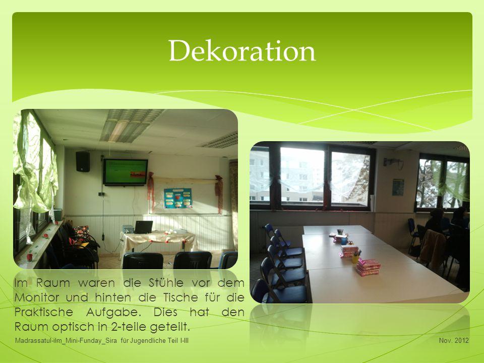 Im Raum waren die Stühle vor dem Monitor und hinten die Tische für die Praktische Aufgabe. Dies hat den Raum optisch in 2-teile geteilt. Dekoration No
