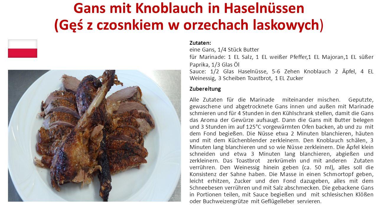 Gans mit Knoblauch in Haselnüssen (Gęś z czosnkiem w orzechach laskowych) Zutaten: eine Gans, 1/4 Stück Butter für Marinade: 1 EL Salz, 1 EL weißer Pf