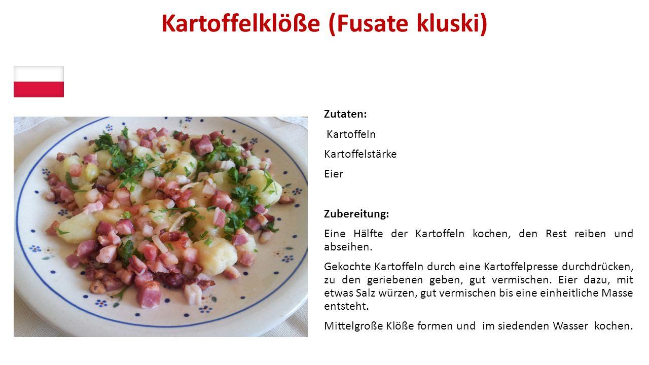 Kartoffelklöße (Fusate kluski) Zutaten: Kartoffeln Kartoffelstärke Eier Zubereitung: Eine Hälfte der Kartoffeln kochen, den Rest reiben und abseihen.