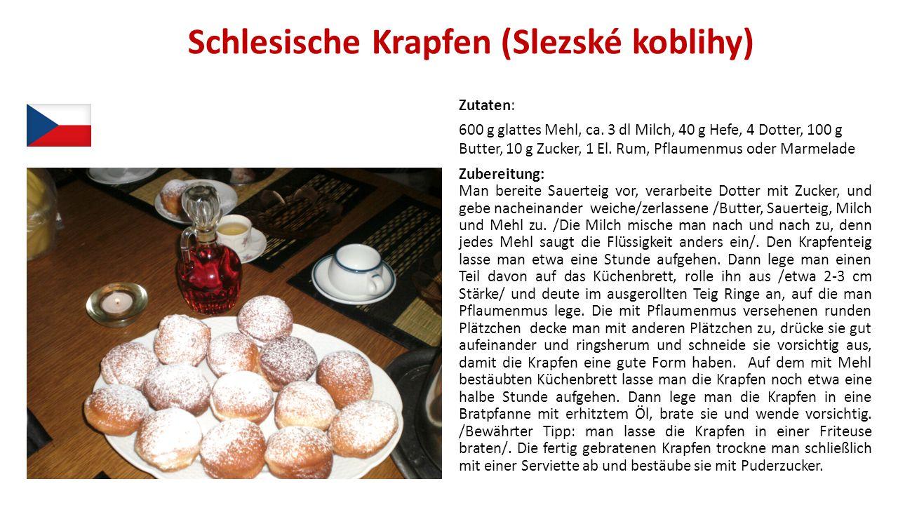 Schlesische Krapfen (Slezské koblihy) Zutaten: 600 g glattes Mehl, ca. 3 dl Milch, 40 g Hefe, 4 Dotter, 100 g Butter, 10 g Zucker, 1 El. Rum, Pflaumen