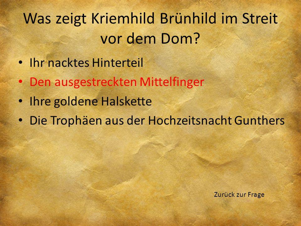 Was zeigt Kriemhild Brünhild im Streit vor dem Dom? Ihr nacktes Hinterteil Den ausgestreckten Mittelfinger Ihre goldene Halskette Die Trophäen aus der