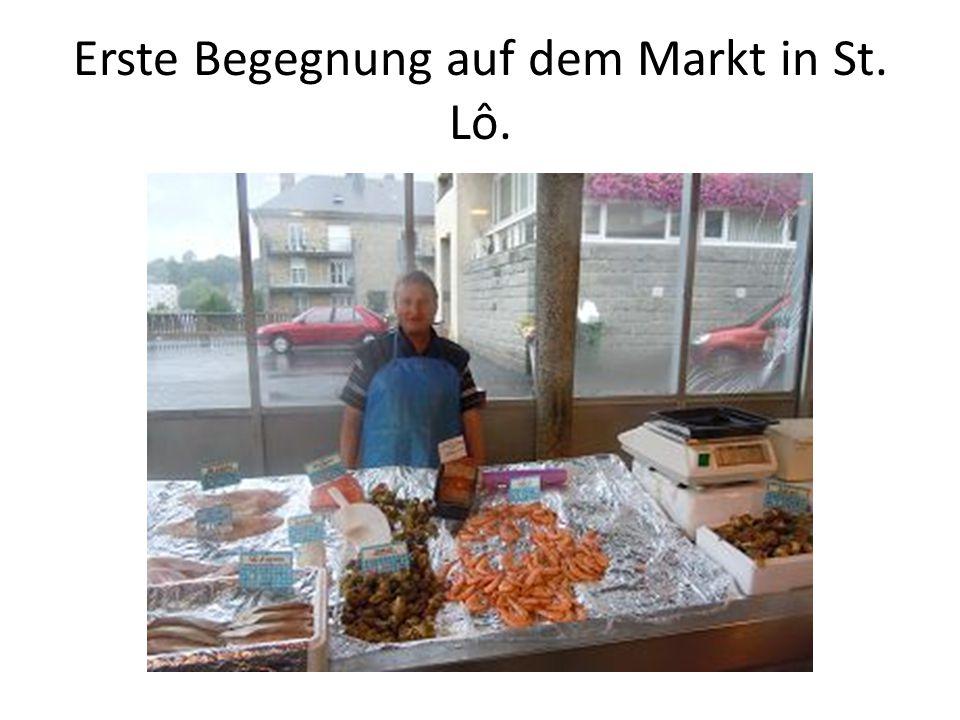 Erste Begegnung auf dem Markt in St. Lô.